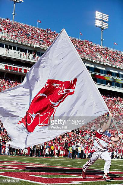 Cheerleader of the Arkansas Razorbacks runs the flag through the end zone after a touchdown against the UAB Blazers at Razorback Stadium on October...