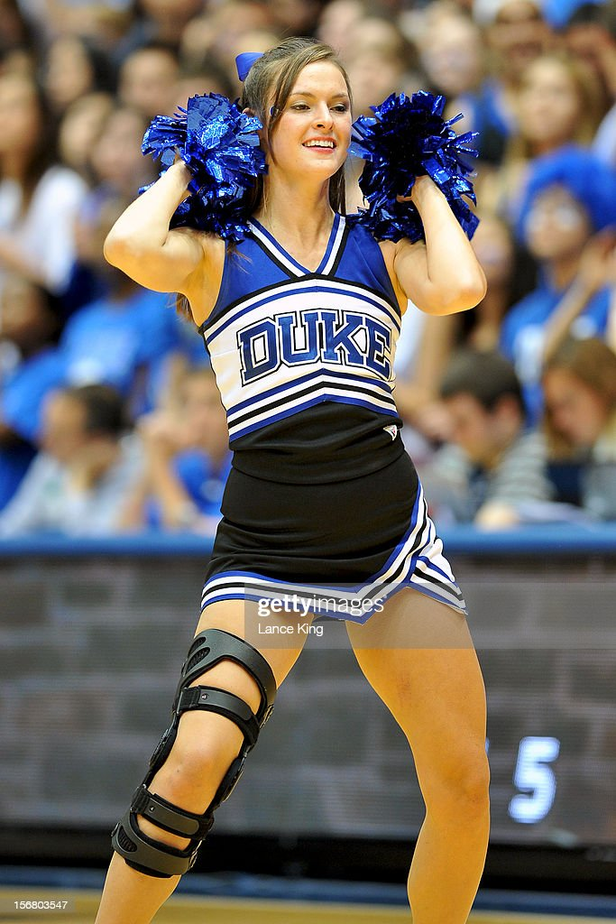 A cheerleader of the Duke Blue Devils performs during a stop in play against the Florida Gulf Coast Eagles at Cameron Indoor Stadium on November 18...