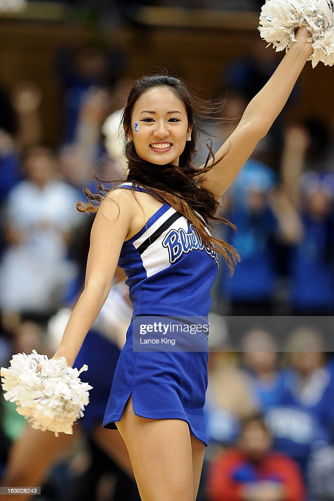 A cheerleader of the Duke Blue Devils performs during a stop in play against the North Carolina Tar Heels at Cameron Indoor Stadium on March 3, 2013 in Durham, North Carolina. Duke defeated North Carolina 65-58.