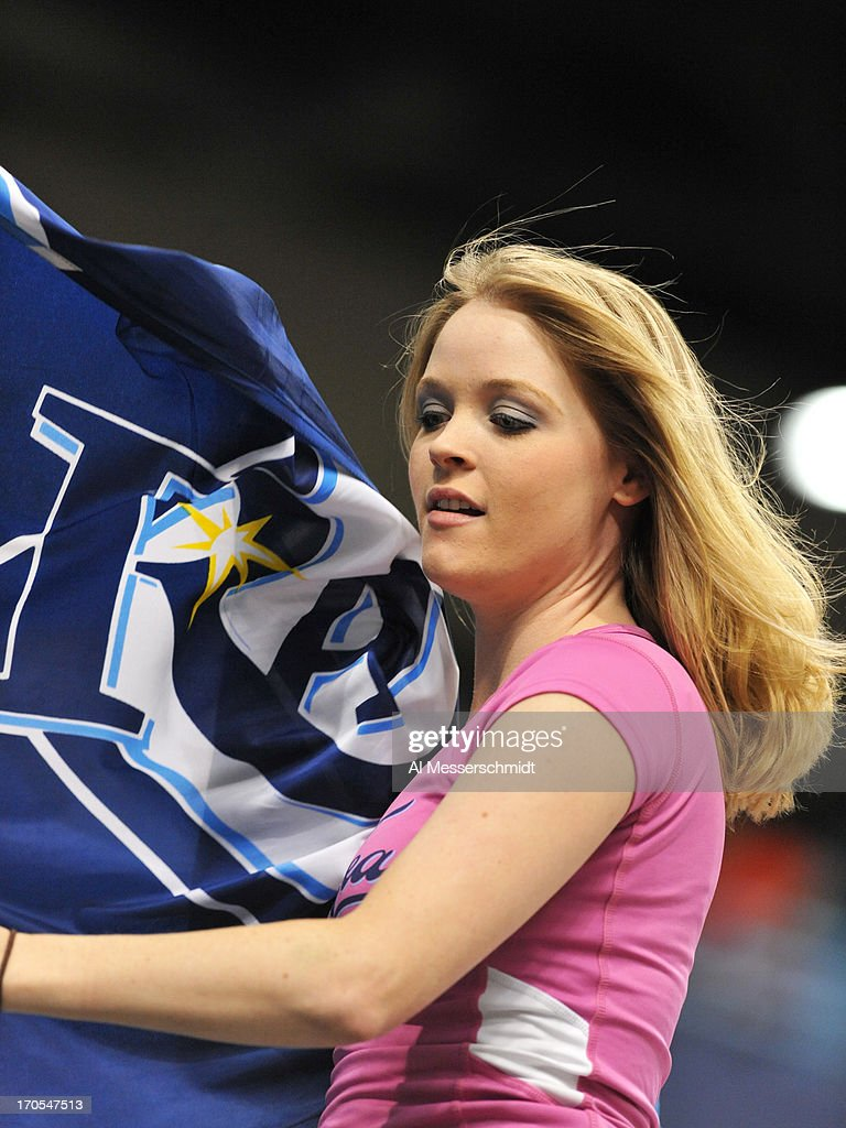 A cheerleader of the Tampa Bay Rays entertains before play against the Boston Red Sox June 11, 2013 at Tropicana Field in St. Petersburg, Florida.