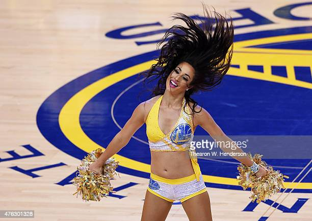 A cheerleader performs during Game Two of the 2015 NBA Finals between the Golden State Warriors and the Cleveland Cavaliers at ORACLE Arena on June 7...