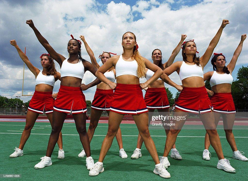 Cheerleader squad striking pose : Stock Photo