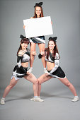 cheerleader team performing a thigh stand