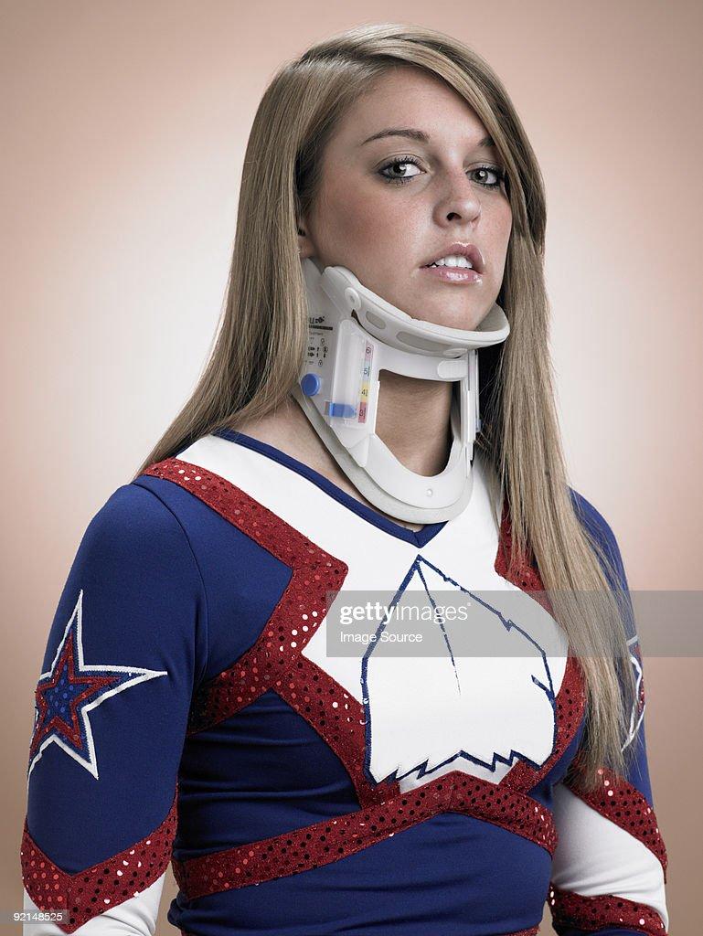Cheerleader wearing a neck brace : Foto de stock