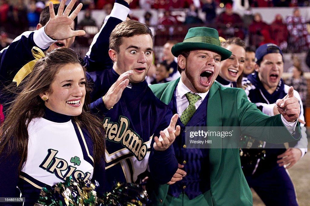 Cheerleaders and Mascot of the Notre Dame Fighting Irish celebrate after a touchdown against the Oklahoma Sooners at Gaylord Family Oklahoma Memorial Stadium on October 27, 2012 in Norman, Oklahoma. The Fighting Irish defeated the Sooners 30-13.