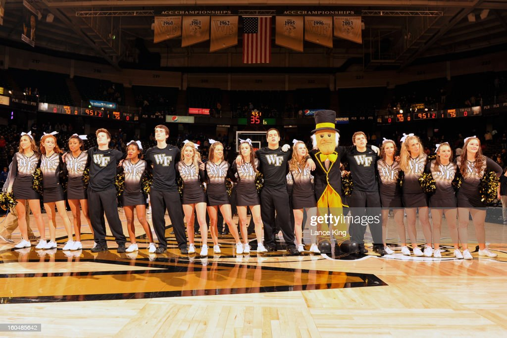 Cheerleaders and the mascot of the Wake Forest Demon Deacons sing following their game against the Duke Blue Devils at Lawrence Joel Coliseum on January 30, 2013 in Winston-Salem, North Carolina. Duke defeated Wake Forest 75-70.