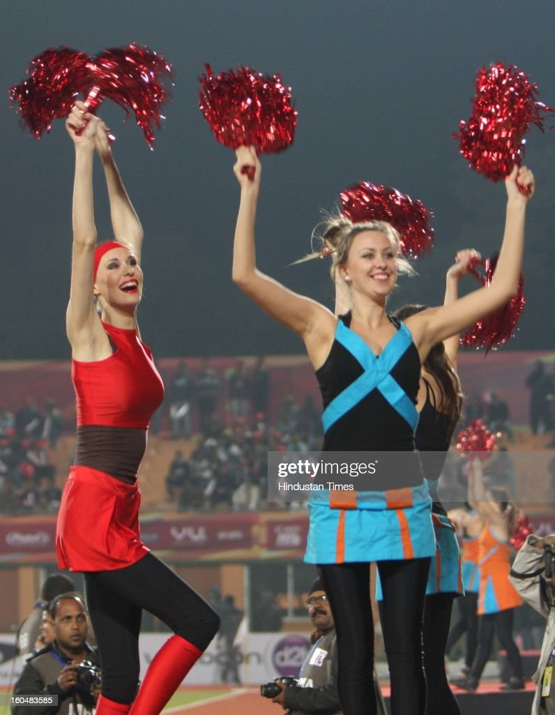 Cheerleaders cheers during Ranchi Rhinos and Delhi Waveriders Hockey match during the Hockey India Leauge (HIL) at Astro Turf Stadium, on February 1, 2013 in Ranchi, India.