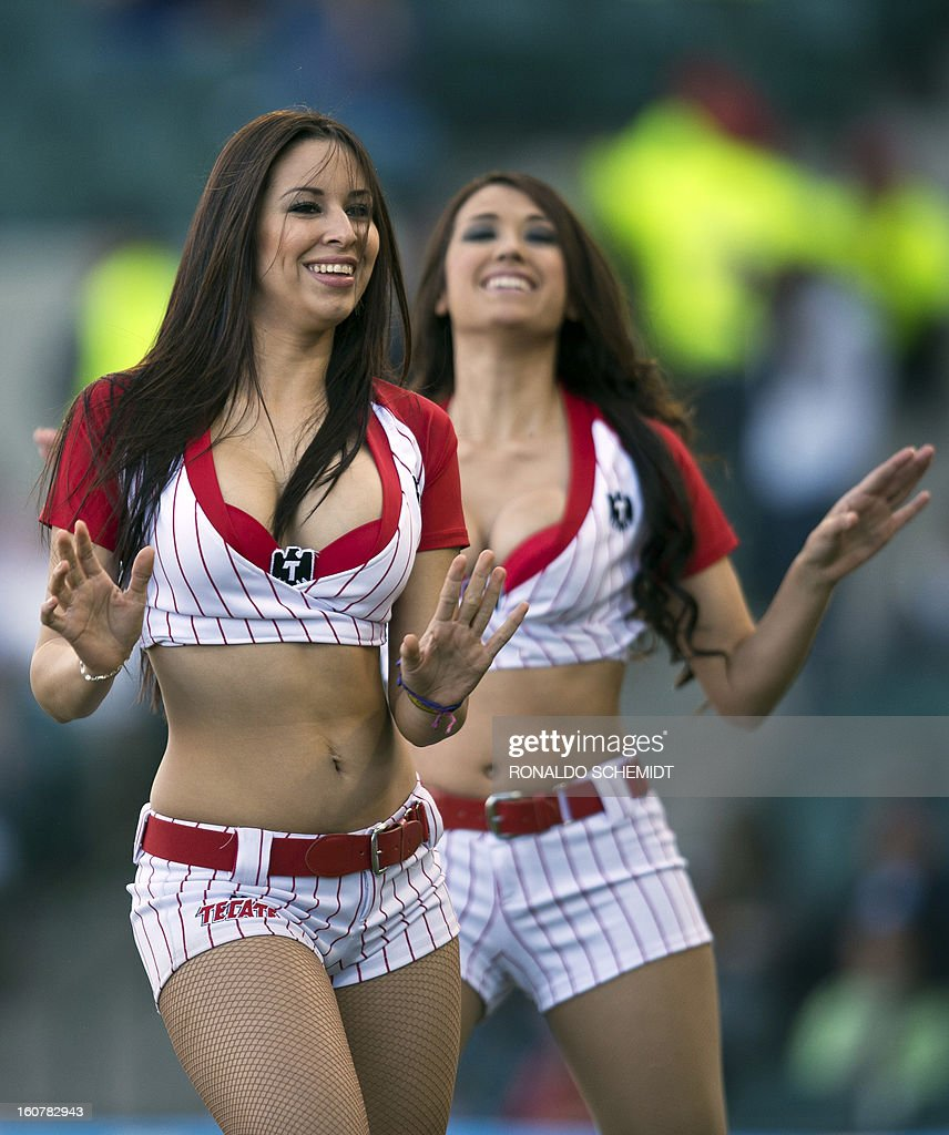 Cheerleaders dance during the game between Magallanes of Venezuela and Criollos de Caguas of Puerto Rico, during the 2013 Caribbean baseball series, on February 5, 2013, in Hermosillo, Sonora State, in the northern of Mexico. AFP PHOTO/Ronaldo Schemidt