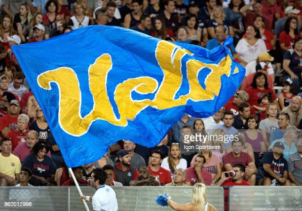 Cheerleaders fly the UCLA flag after a scoring play during the college football game between the UCLA Bruins and the Arizona Wildcats on October 14...