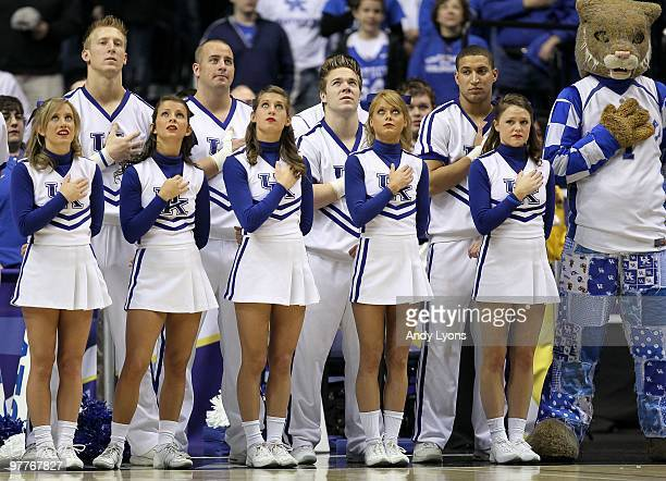 Cheerleaders for the Kentucky Wildcats stand for the performance of the National Anthem against the Mississippi State Bulldogs during the final of...