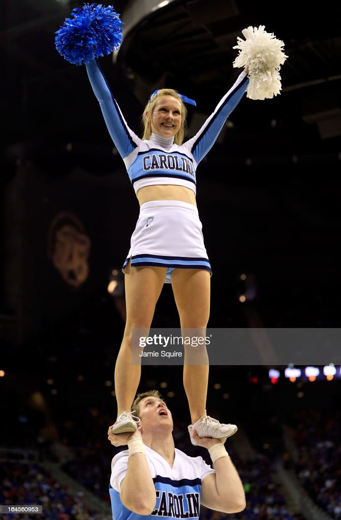 Cheerleaders for the North Carolina Tar Heels perform against the Kansas Jayhawks during the third round of the 2013 NCAA Men's Basketball Tournament at Sprint Center on March 24, 2013 in Kansas City, Missouri.