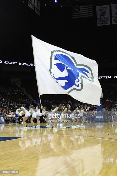 Cheerleaders for the Seton Hall Pirates perform with a giant school flag during a time out against the Auburn Tigers at Prudential Center on December...
