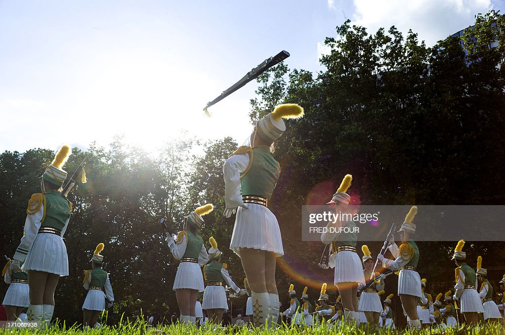Cheerleaders from Taipei, Taiwan perform during the 32nd edition of the annual music event 'La Fete de la Musique' on June 21, 2013 in Paris. The event takes place across the streets of France, with thousands of musicians performing for one of the nation's most popular festivals celebrating rythm and sound.