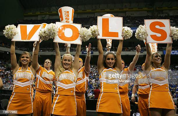 Cheerleaders from the Tennessee Volunteers holds up signs that spell 'Vols' as they perform against the Ohio State Buckeyes during the round of 16 of...