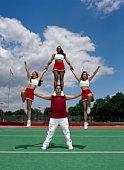 Cheerleaders in acrobatic formation