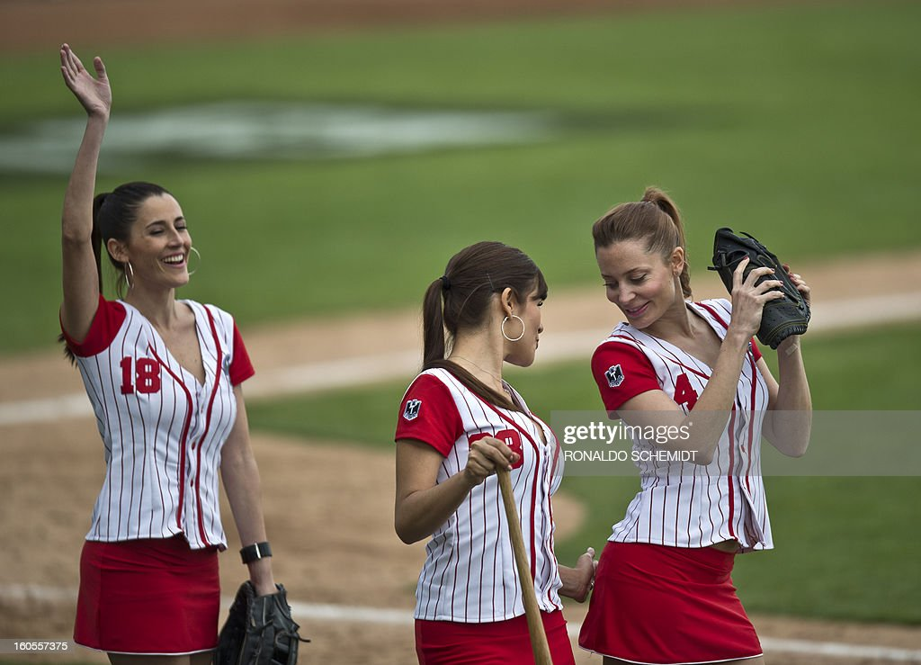 Cheerleaders joke during the baseball game between Criollos de Caguas of Puerto Rico and Leones del Escogido of Dominican Republic, during the 2013 Baseball Caribbean Series, on February 2, 2013, in Hermosillo, Sonora State, northern Mexico. AFP PHOTO/Ronaldo Schemidt