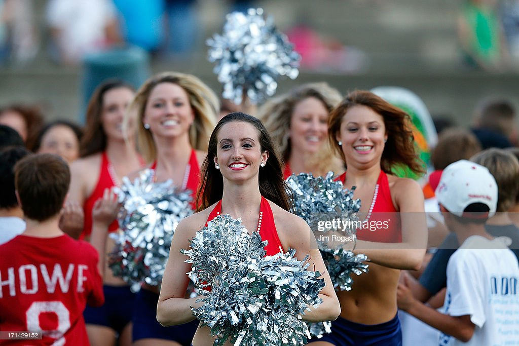 Cheerleaders of the Boston Cannons run on to the field before a game against the New York Lizards at Harvard Stadium on June 21, 2013 in Boston, Massachusetts.