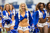 Cheerleaders of the Dallas Cowboys perform before a game against the Arizona Cardinals at ATT Stadium on November 2 2014 in Arlington Texas The...