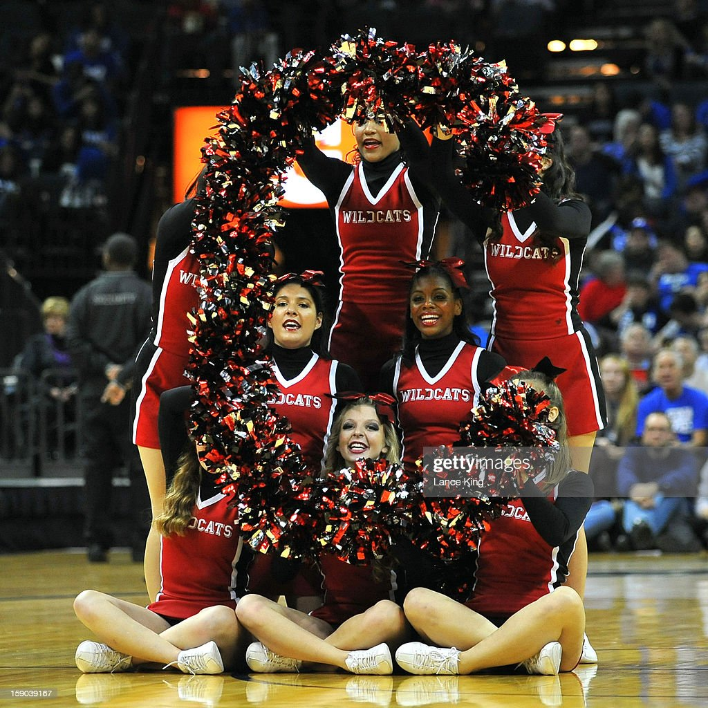 Cheerleaders of the Davidson Wildcats perform during a stop in play against the Duke Blue Devils at Time Warner Cable Arena on January 2, 2013 in Charlotte, North Carolina. Duke defeated Davidson 67-50.