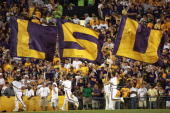 Cheerleaders of the LSU Tigers carries flags against the Florida Gators at Tiger Stadium on October 6 2007 in Baton Rouge Louisiana LSU defeated...