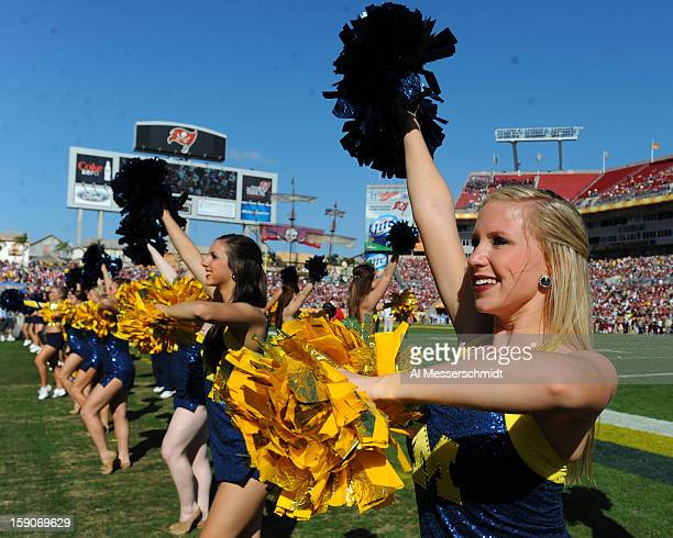 Cheerleaders of the Michigan Wolverines entertain during play against the South Carolina Gamecocks in the Outback Bowl January 1 2013 at Raymond...