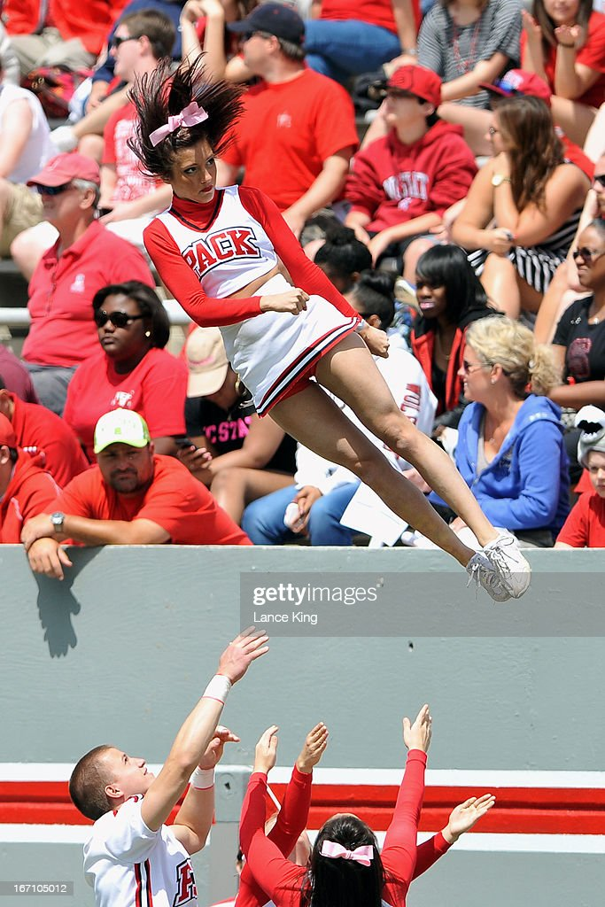 Cheerleaders of the North Carolina State Wolfpack perform during the Kay Yow Spring Football Game at Carter-Finley Stadium on April 20, 2013 in Raleigh, North Carolina.