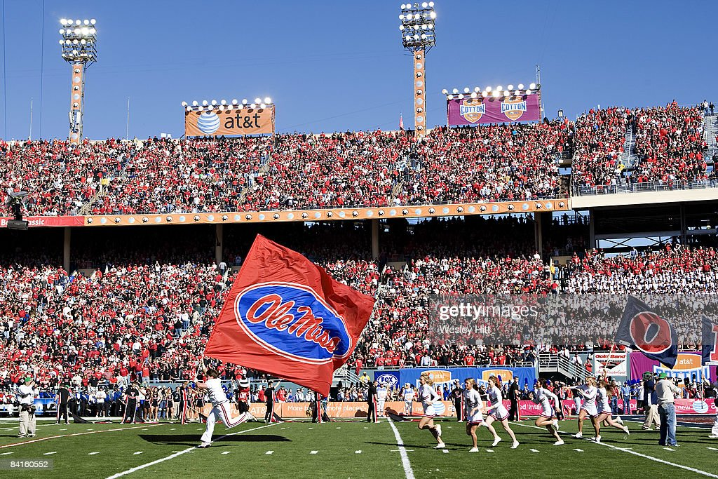Cheerleaders of the Ole Miss Rebels run onto the field before the ATT Cotton Bowl against the Texas Tech Red Raiders on January 2 2009 at the Cotton...