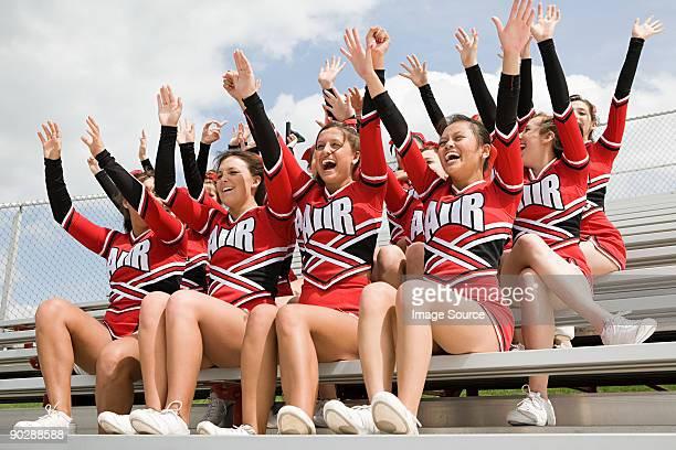 Cheerleaders on bleachers