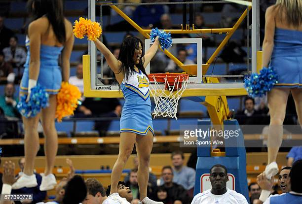 Cheerleaders perform during a college basketball game between the Loyola Marymount Lions and the UCLA Bruins played at Pauley Pavilion in Westwood CA