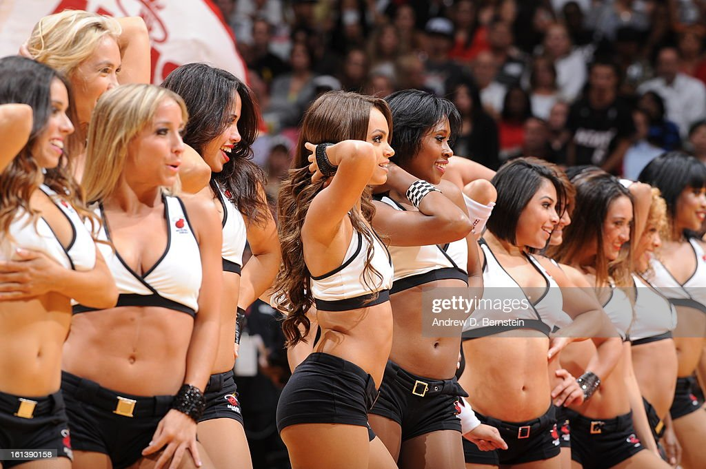 Cheerleaders perform during a game between the Los Angeles Lakers and the Miami Heat on February 10, 2013 at American Airlines Arena in Miami, Florida.