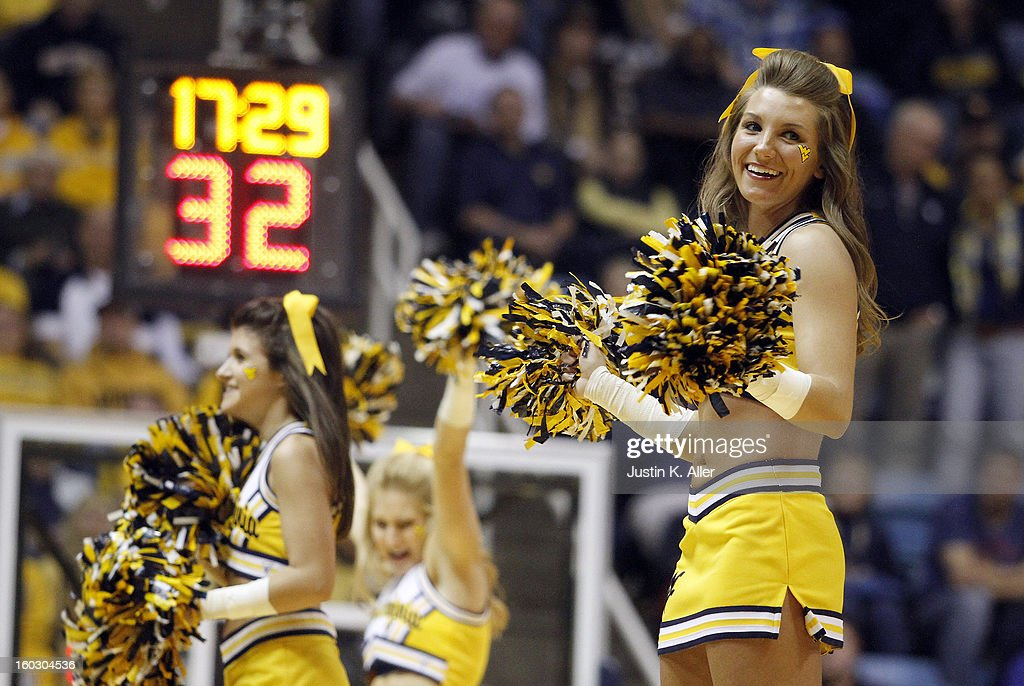 WVU cheerleaders perform during a time out during the game against the Kansas Jayhawks at the WVU Coliseum on January 28, 2013 in Morgantown, West Virginia. The Jayhawks defeated WVU