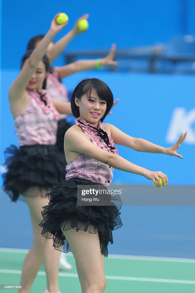 Cheerleaders perform during day four of the 2014 Dongfeng Motor Wuhan Open at Wuhan Optics Valley International Tennis Center on September 24 2014 in...