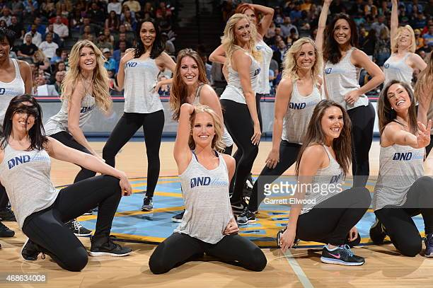 Cheerleaders perform during the game between the Los Angeles Clippers and Denver Nuggets on April 4 2015 at the Pepsi Center in Denver Colorado NOTE...