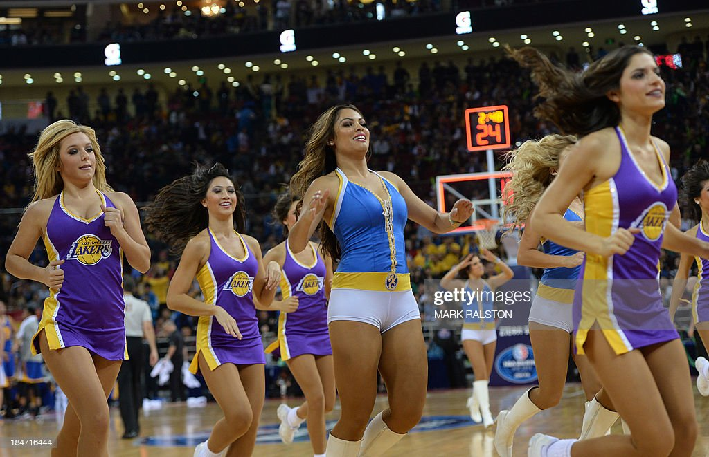 Cheerleaders perform during the LA Lakers and Golden State Warriors NBA Global Game 2013 tour game at the Wukesong Stadium in Beijing on October 15, 2013. The Warriors went on to win 100-95. The NBA Global Games sees a total of 12 NBA teams playing in seven different countries around the world. AFP PHOTO /Mark RALSTON