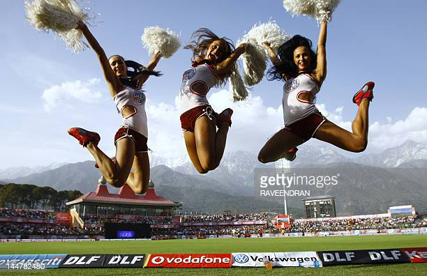 IPL cheerleaders perform for the Delhi Daredevils during the IPL Twenty20 cricket match between Kings XI Punjab and Delhi Daredevils at Himachal...