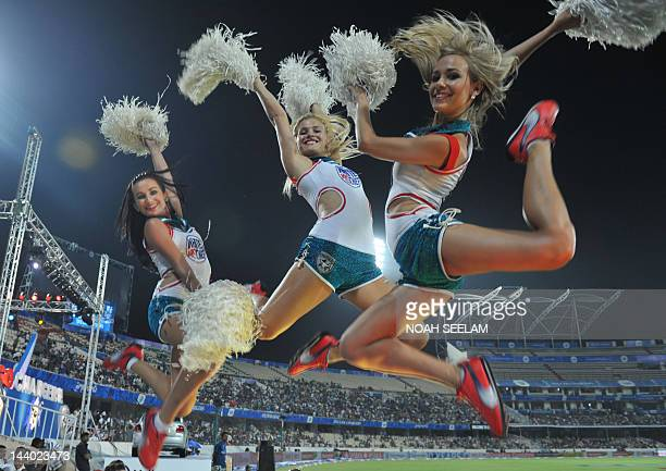 Cheerleaders perform prior to the start of the IPL Twenty20 cricket match between Deccan Chargers and Kings XI Punjab at the Rajiv Gandhi...