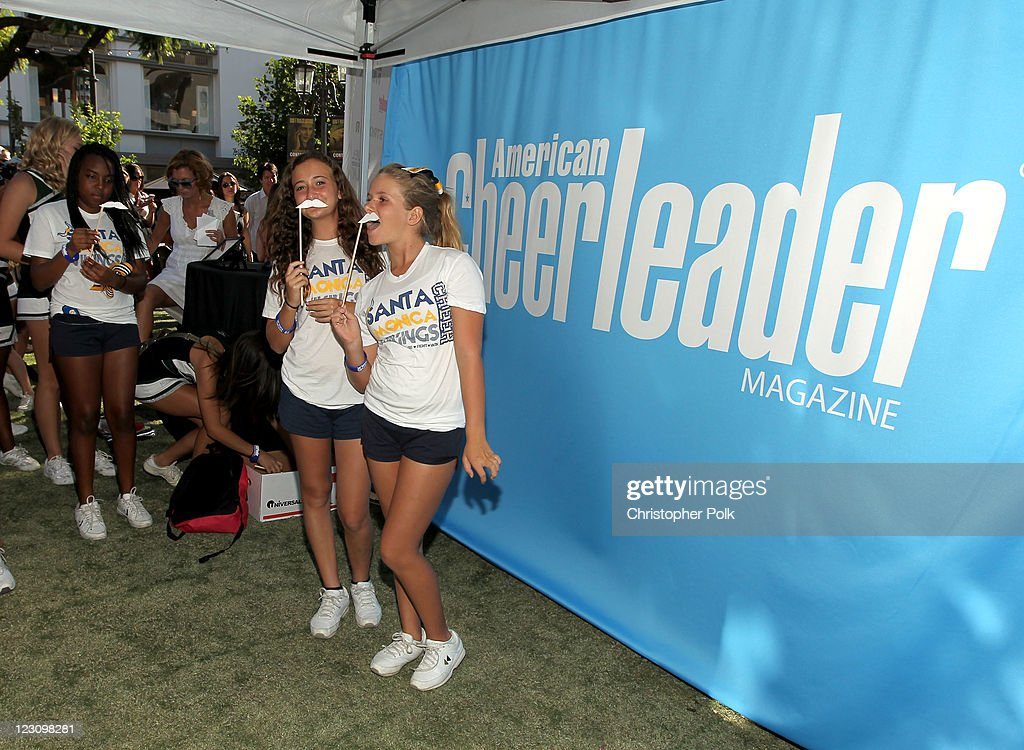 Cheerleaders pose at the Milk Mustache photobooth during the 'Be Strong' Challenge with Ashley Tisdale held at The Grove on August 30, 2011 in Los Angeles, California.