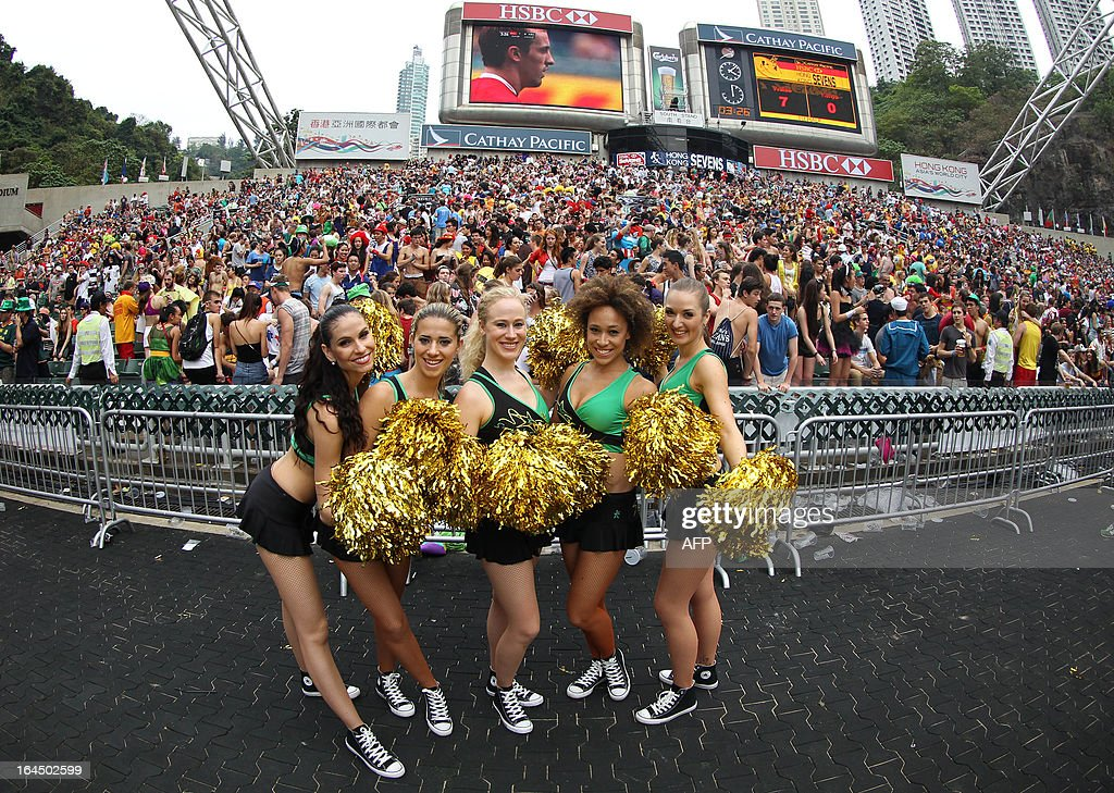 Cheerleaders pose for a photograph during the final day of the Hong Kong Rugby Sevens tournament on March 24, 2013. AFP PHOTO / Dale de la Rey