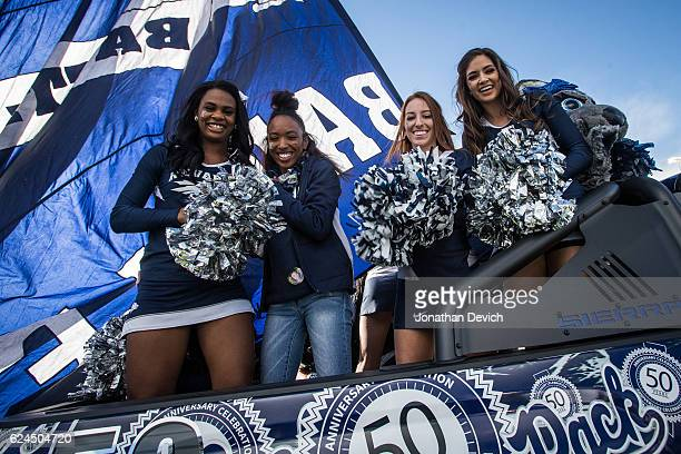 Cheerleaders pose on the back of the Nevada Wolf Pack truck before they lead out the team to take on the Utah State Aggies at Mackay Stadium on...