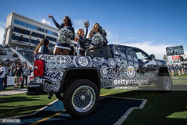 Cheerleaders ride onto the field to bring out the Nevada Wolf Pack players before they take on the Utah State Aggies at Mackay Stadium on November 19...