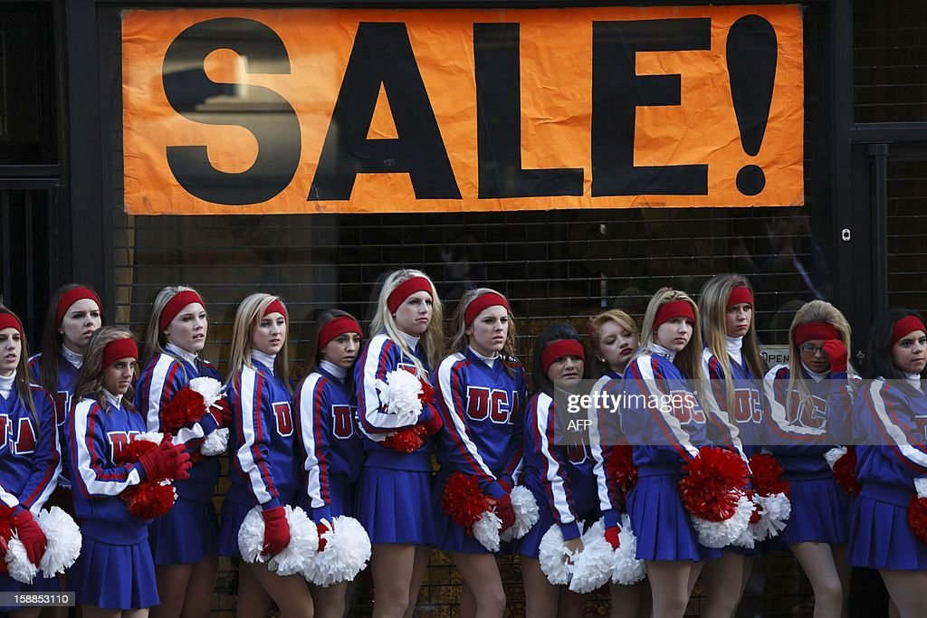 Cheerleaders wait in line before taking part in the New Year's Day Parade in central London on January 1, 2013. London bade farewell to a golden year of Olympic and royal spectaculars with a fireworks extravaganza over the River Thames that welcomed in 2013. AFP PHOTO / JUSTIN TALLIS