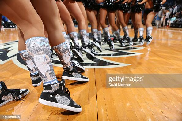 Cheerleaders wear socks in support of Andrew Wiggins of the Minnesota Timberwolves being the Rookie of the Year during a game against the New Orleans...