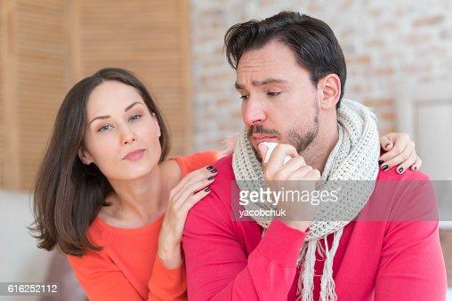 Cheerless depressed man suffering from fever : Foto de stock