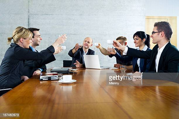 Cheers. Business people toasting to each other.