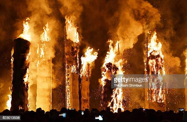 Cheers erupt each time a huge torch is burned down during a festival known as Taimatsu Akashi on November 12 2016 in Sukagawa Fukushima Japan Bamboo...