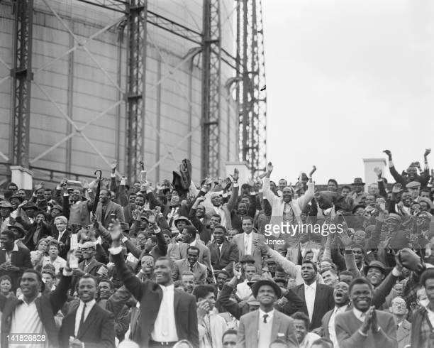 Cheers from West Indian spectators after an England wicket fell in their second innings of the 5th and final test match at the Oval in London 24th...