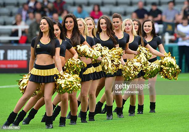 Cheers leaders entertaining the crowd during the Singha Premiership Rugby 7s series at Kingston Park Stadium on August 22 2015 in Newcastle Upon Tyne...