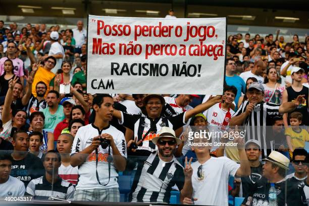 Cheers of Atletico before the match between Santos and Atletico MG for the Brazilian Series A 2014 at Arena Pantanal on May 18 2014 in Cuiaba Brazil...