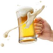 hand holding a mug of beer toasting