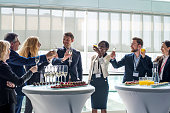 Cheerful business people toasting to success